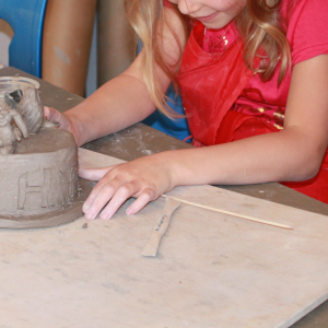 Children in ceramic art class in Hertford