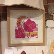 A framed picture of poppies on the beach by kate heiss available to buy in the gift shop at courtyard arts