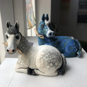 A picture of two ornamental horses available to buy at the gift shop at courtyard arts centre